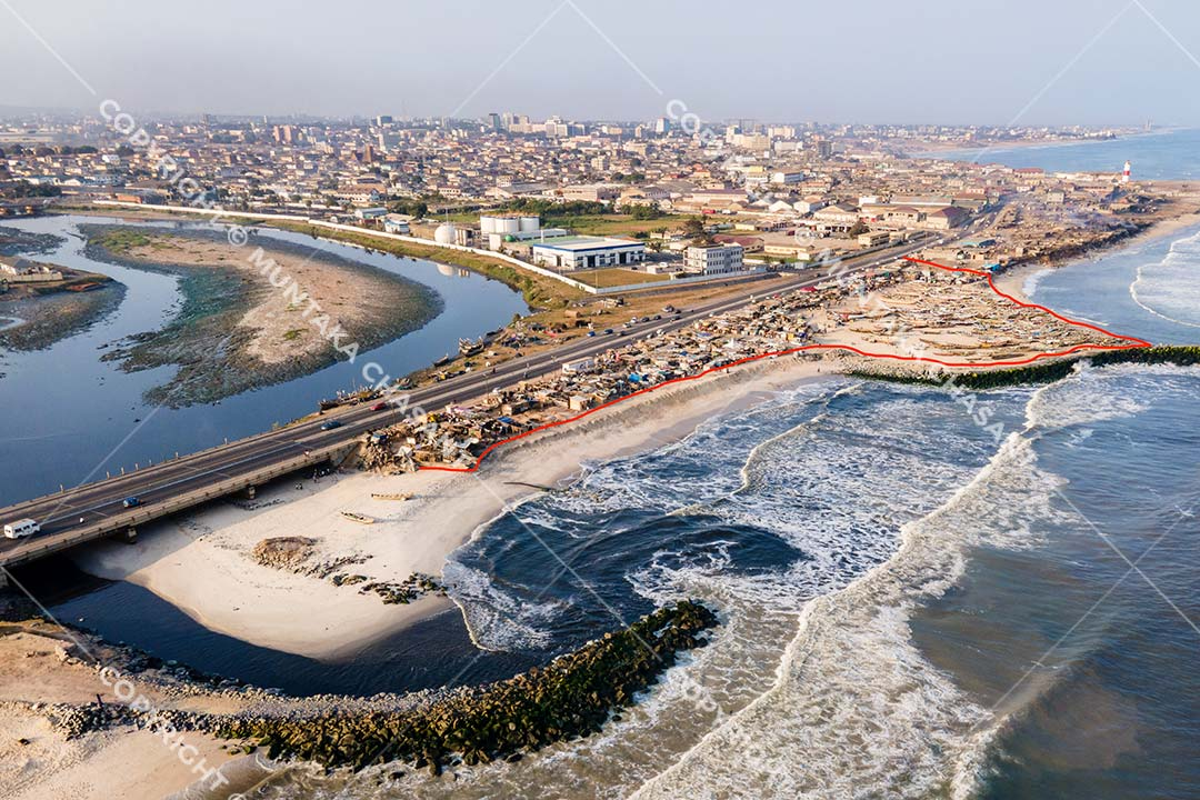 Korle Lagoon: Aerial view of Korle Lagoon estuarine environment near Jamestown in Accra, Ghana. Fed by the Odaw River, the Korle Lagoon collects industrial effluent, wastewater, and all kinds of debris from Accra's major drainage channels and empties them into the Gulf of Guinea. Copyright © 2020 Muntaka Chasant