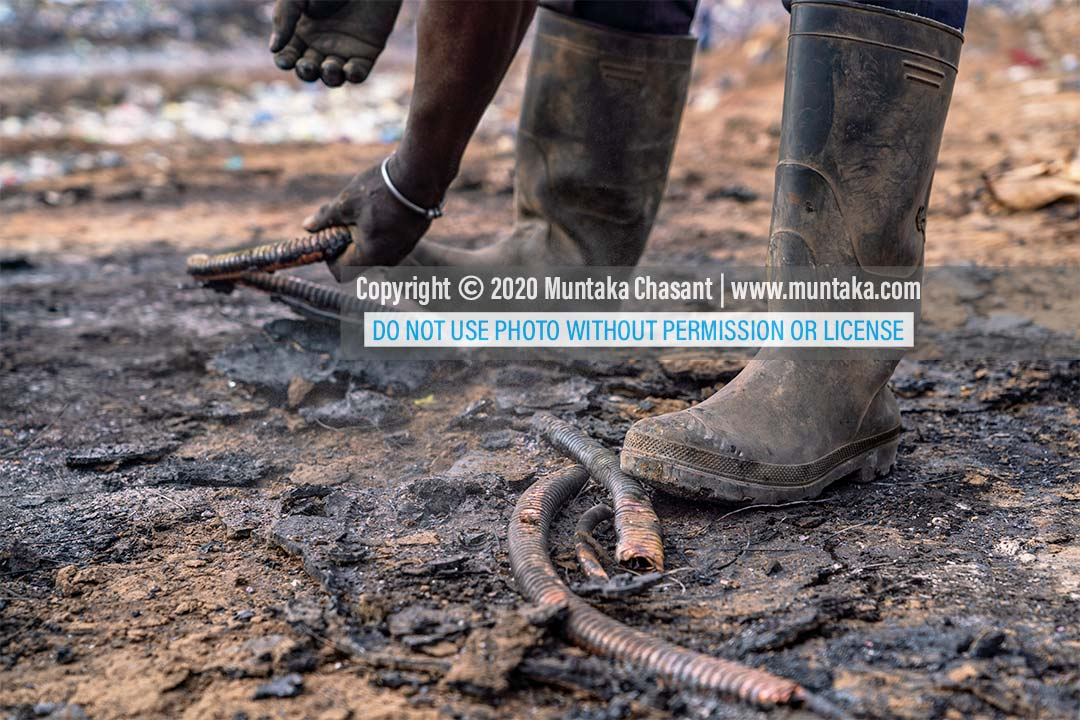 Man recycles heliax coaxial cables that are used to carry high-frequency signals by burning them in the open to remove the PVC/PE sheaths and foams. Copyright © 2020 Muntaka Chasant
