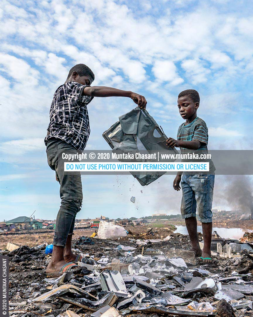 Child labour: Osei, 15 years old, had just helped Ibrahim, 11 years, to recover a shadow mask from an old CRT TV at Agbogbloshie, Ghana. Iron scrap sold for around $0.15 per kilo at Agbogbloshie in May 2020. © 2020 Muntaka Chasant