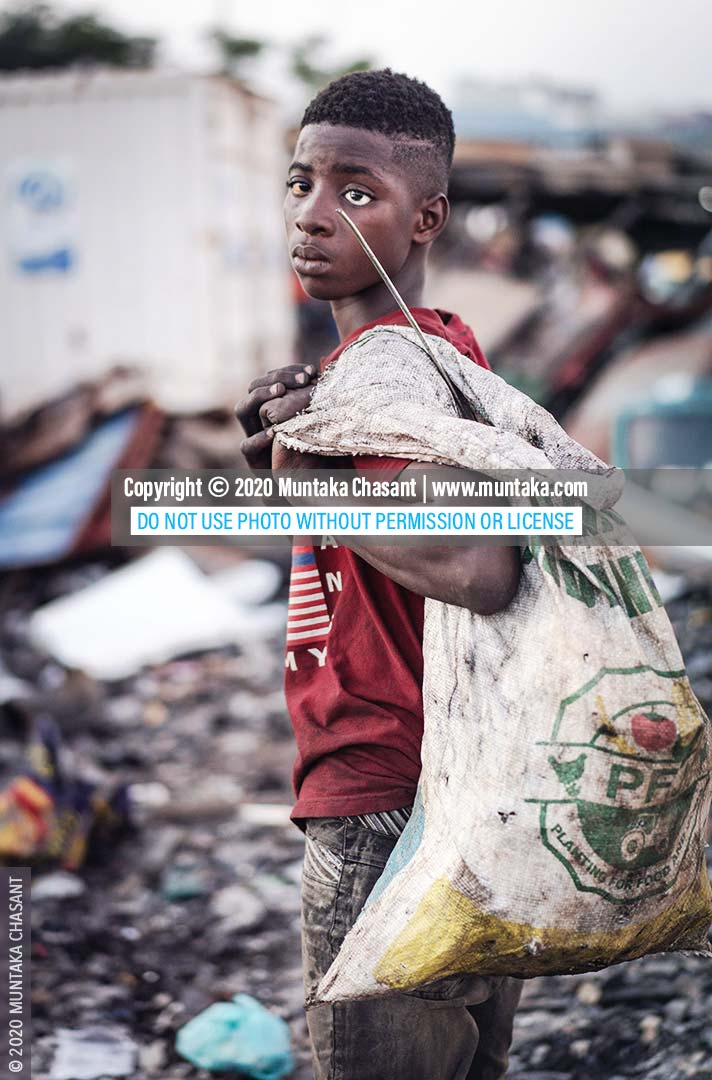 Hazardous child labour: 15-year-old Debrah scavenges for scrap metals and uses his bare hands to break apart e-waste for the precious metals inside on the margins of Agbogbloshie, Ghana. The minimum age for hazardous work in Ghana is 18, according to Section 91 of the Children's Act, 1998 (Act 560). © 2020 Muntaka Chasant