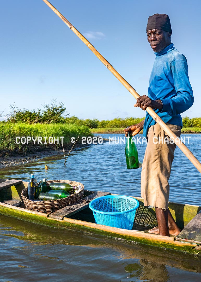 Fishing methods in Ghana: Fisherman in Ghana use bottles to catch tilapia in a mangrove and tidal salt marshes area in Ghana. Copyright © 2020 Muntaka Chasant