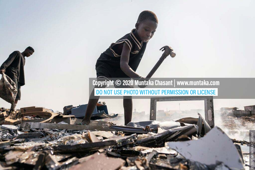 Child labour: 9-year-old Kwadwo is using a hammer to break apart a cathode-ray tube-based TV for the iron materials inside at Agbogbloshie, Ghana. This exposed him to dangerous levels of lead. © 2020 Muntaka Chasant