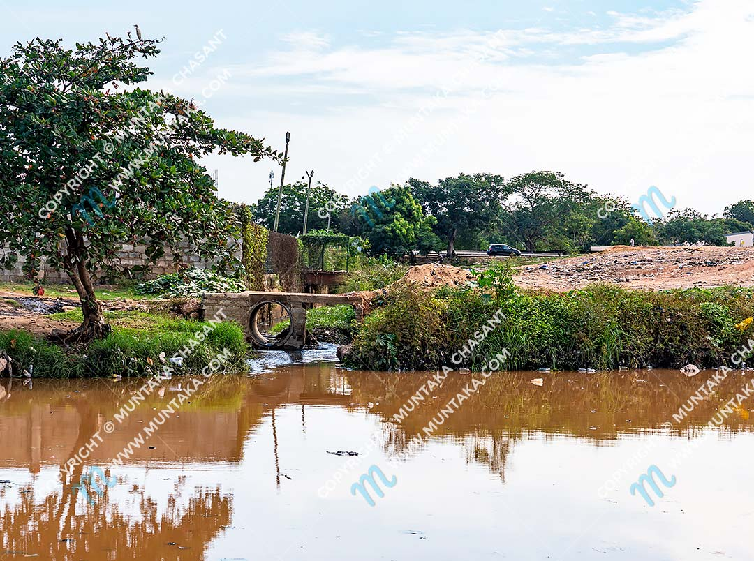 Korle Lagoon and Korle Bu Teaching Hospital: Photograph of where wastewater from Korle Bu, Ghana's premier healthcare facility, empties into the Korle lagoon. Copyright © 2020 Muntaka Chasant