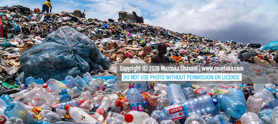 Plastic pollution image: Urban poor man sorts recyclable plastics at a dump in Accra, Ghana. September 2020. Copyright © 2020 Muntaka Chasant