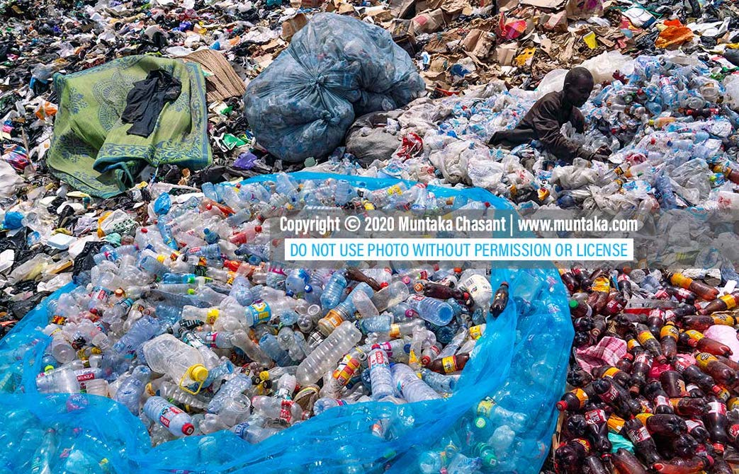 Plastic pollution: Man sorts plastic waste in Accra, Ghana. Only a small percentage of plastics in Africa are recycled each year. The rest accumulates in the environment or are burned. Copyright © 2020 Muntaka Chasant