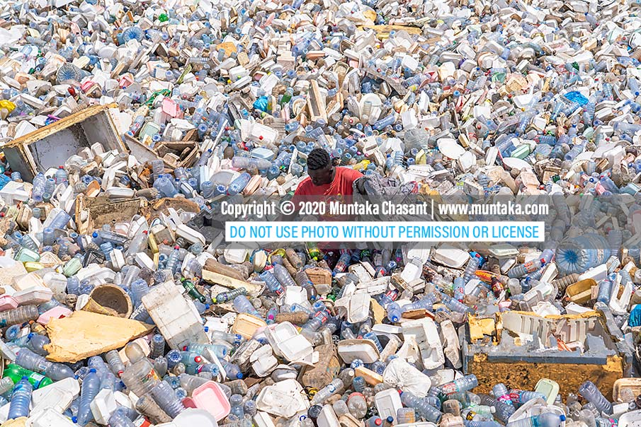 Plastic pollution picture: A 2020 photograph of an urban poor man recovering recyclable plastics in the Korle Lagoon, Accra, Ghana. Copyright © 2020 Muntaka Chasant