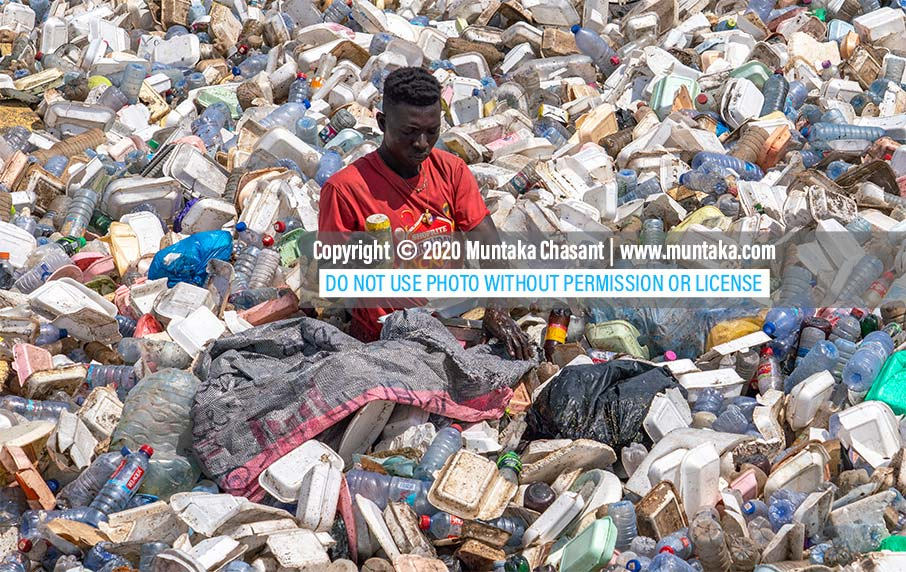 Plastic pollution photo: Urban poor man recovers recyclable plastics from the polluted Korle Lagoon in Accra, Ghana's capital city. Only around 9% of the 8.3 billion tons of plastics that have been produced since the 1950s have been recycled. Copyright © 2020 Muntaka Chasant