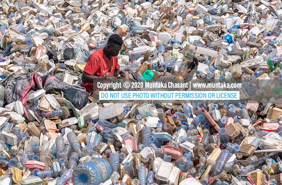 Plastic waste in Ghana: Plastic pollution is destroying Ghana's water bodies. A young man is busy recovering recyclable plastic waste in the Korle Lagoon in Accra. Only 5% of the plastic waste generated in Ghana every year are recycled. Copyright © 2020 Muntaka Chasant
