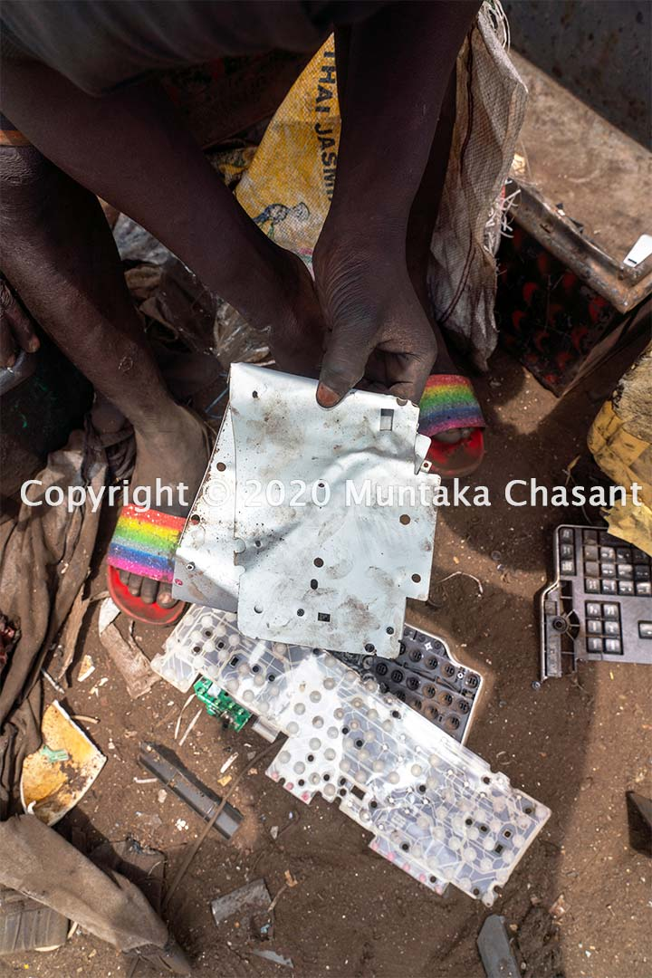 Joseph Akwah, 17 years old, had just recovered metal from a scrap computer keyboard. Copyright © 2020 Muntaka Chasant