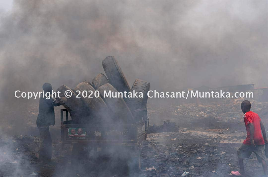 Agbogbloshie September 2020: Scrap tires about to be unloaded and incinerated in the open for steel wires. This is a major source of air pollution in Accra, Ghana's capital city. Copyright © 2020 Muntaka Chasant