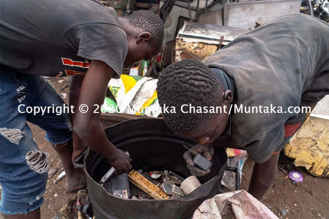Benjamin Duodu, 14 years old, and Joseph Akwah, 17, sort scavenged scraps at Agbogbloshie, Accra, Ghana. Copyright © 2020 Muntaka Chasant