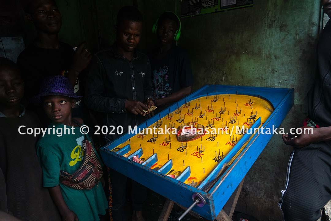 Child gambling: 11-year-old Ibrahim Tanko and other children engaged in hazardous child labour gambling around 7 AM. Copyright © 2020 Muntaka Chasant