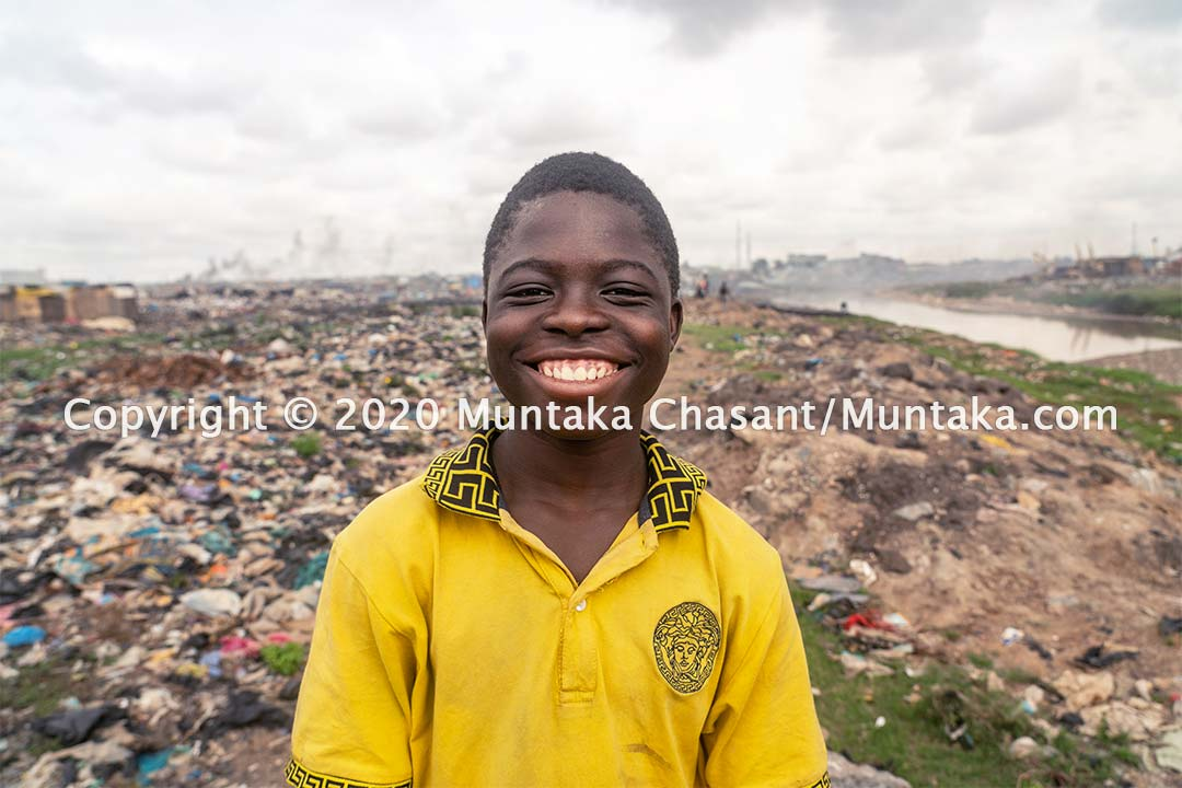 16-year-old child labourer Ali Fuhaadh smile for the camera. Agbogbloshie, Accra, Ghana. Copyright © 2020 Muntaka Chasant