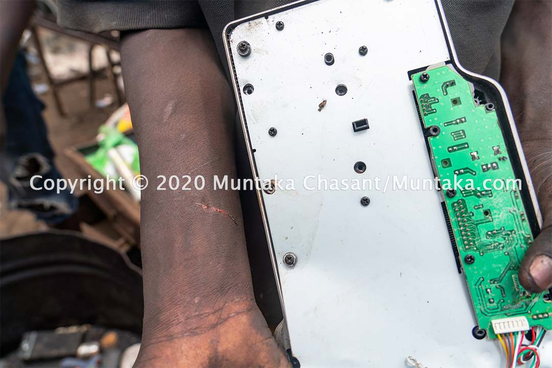 Child labour and e-waste: Joseph Akwah, 17 years, cut as he manually dismantles a scrap computer keyboard for metal. Copyright © 2020 Muntaka Chasant