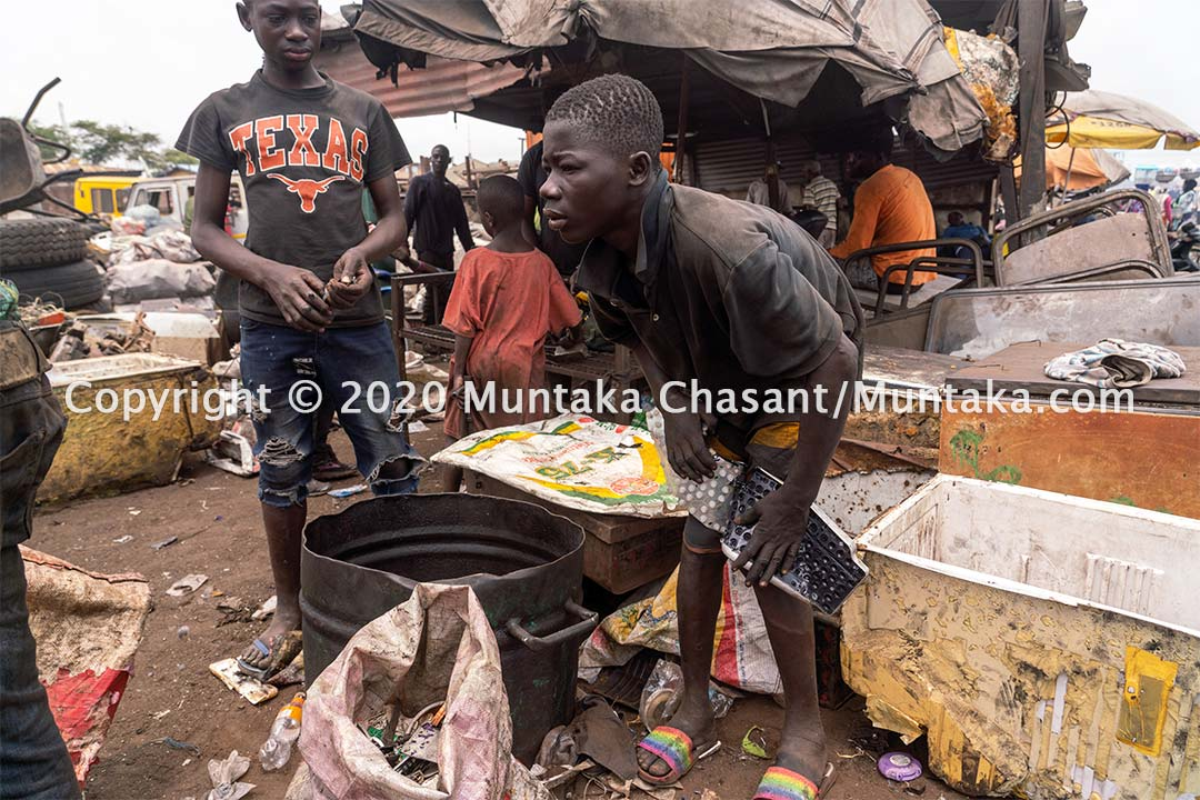 A 17-year-old Ghanaian adolescent boy engaged in hazardous child labour manually dismantles a computer keyboard for scrap metal at Agbogbloshie. Copyright © 2020 Muntaka Chasant