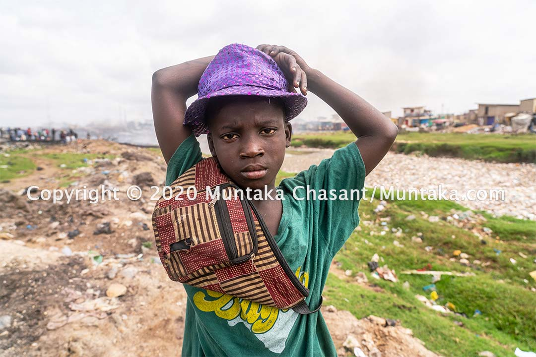 Ibrahim Tanko is an 11 years old boy engaged in child labour on the fringes of Agbogbloshie, Ghana. Copyright © 2020 Muntaka Chasant