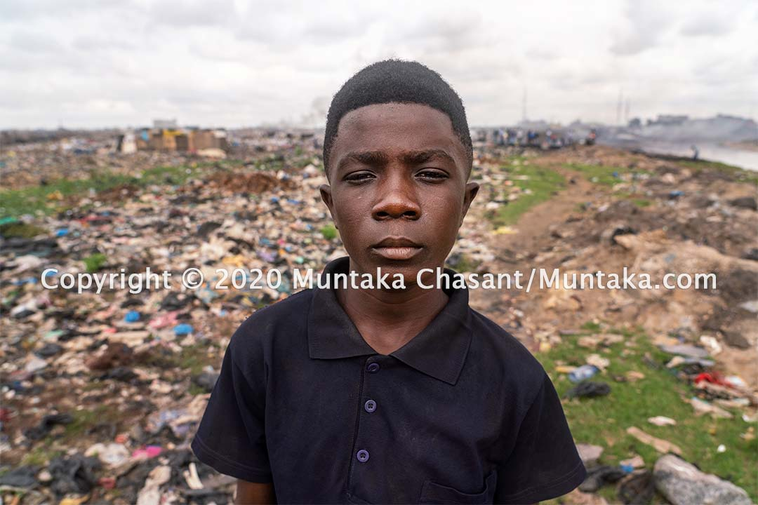 Child labour portrait: Osei, 15 years old, is engaged in hazardous child labour on the margins of Accra, Ghana's capital city. Copyright © 2020 Muntaka Chasant