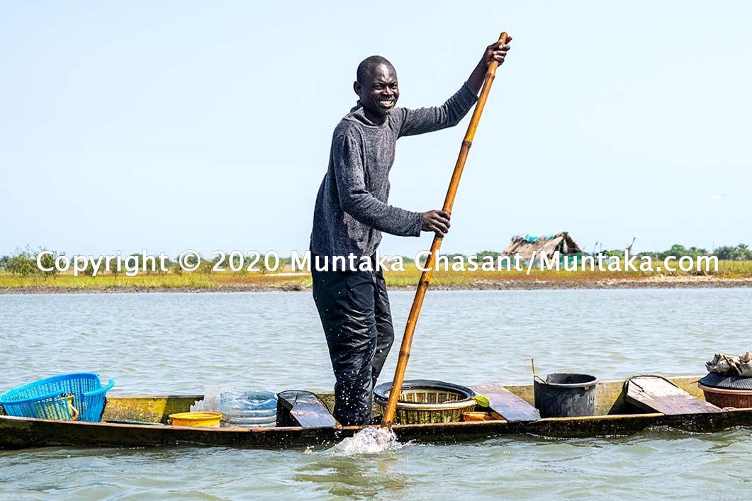 Fisherman in a canoe. Accra, Ghana. Copyright © 2020 Muntaka Chasant