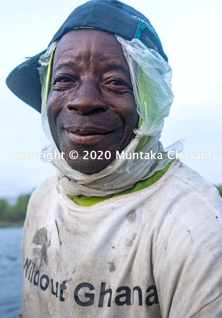 A 76 years old urban poor fisherman work through early evening hours. Copyright © 2020 Muntaka Chasant