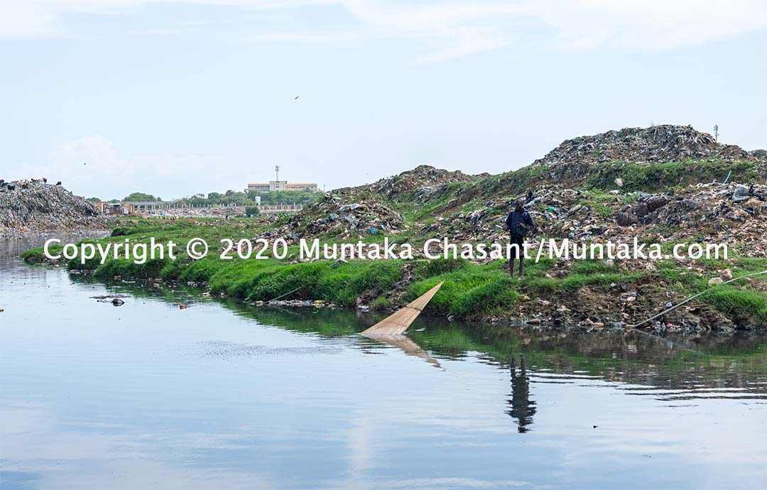Fishing in Ghana: Man fishes in the polluted Korle Lagoon. Copyright © 2020 Muntaka Chasant