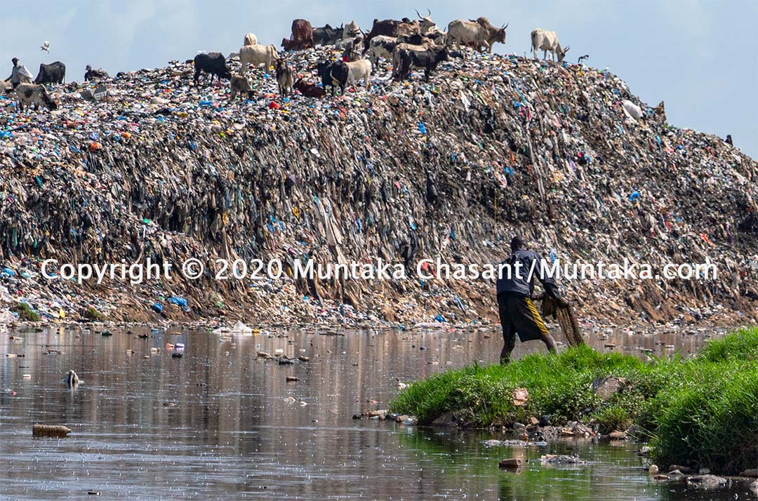 Fishing in Ghana: Frustrated urban poor fisherman gets ready to casts his fishing net over the heavily polluted Korle Lagoon. Copyright © 2020 Muntaka Chasant