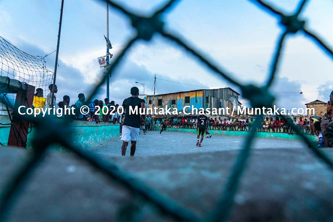 Football in Ghana: Men play street football on concrete at Jamestown, Accra, Ghana. Copyright © 2020 Muntaka Chasant