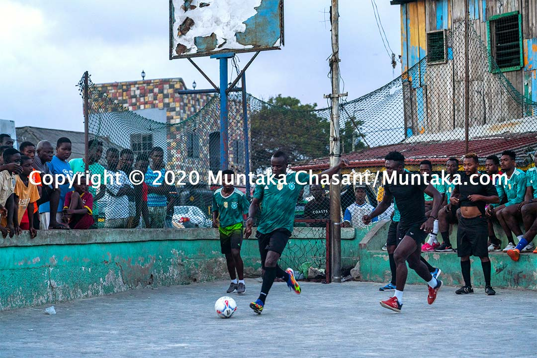 Joshua Clottey plays street football in Accra, Ghana. Copyright © 2020 Muntaka Chasant