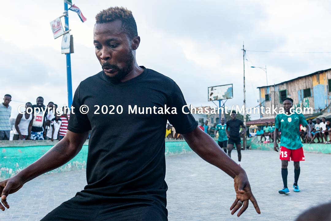 Football in Ghana: Man dribbles as he plays street football in Ghana. Copyright © 2020 Muntaka Chasant