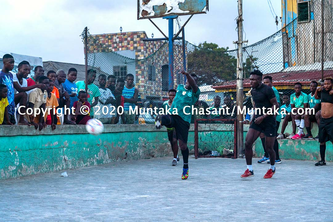 Former Ghanaian professional boxer Joshua Clottey kicks a ball at Jamestown, Accra, Ghana. Copyright © 2020 Muntaka Chasant