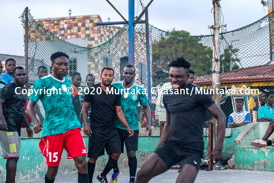 Former IBF welterweight champion Joshua Clottey plays street football in Accra, Ghana. Copyright © 2020 Muntaka Chasant