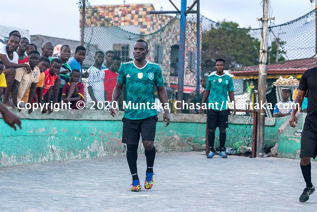 The professional boxer Joshua Clottey plays street football in Accra, Ghana. Copyright © 2020 Muntaka Chasant
