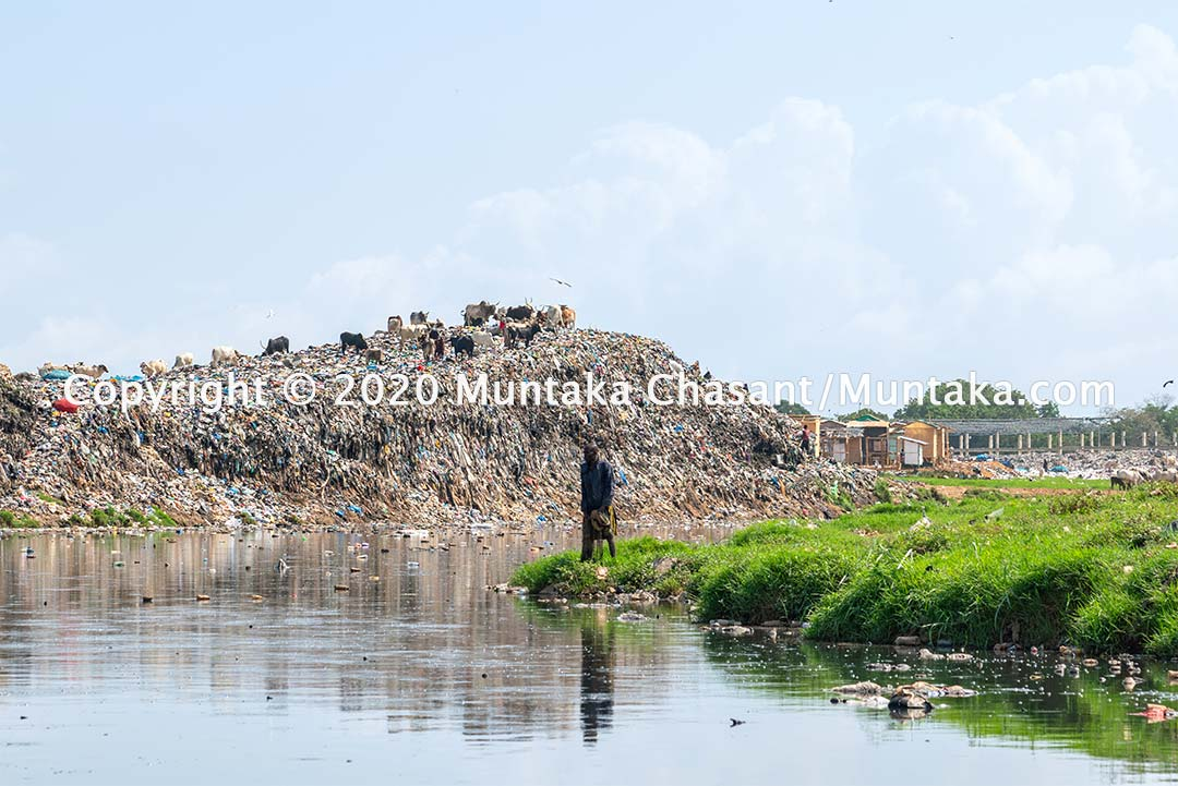 Urban poor Ghanaian fisherman fishes in the polluted Korle Lagoon in Accra, Ghana. Copyright © 2020 Muntaka Chasant