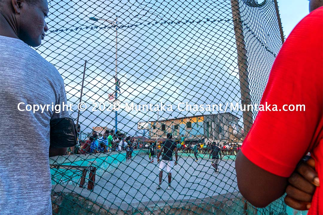 Football in Ghana: Men play football on concrete in Accra, Ghana's capital city. Copyright © 2020 Muntaka Chasant