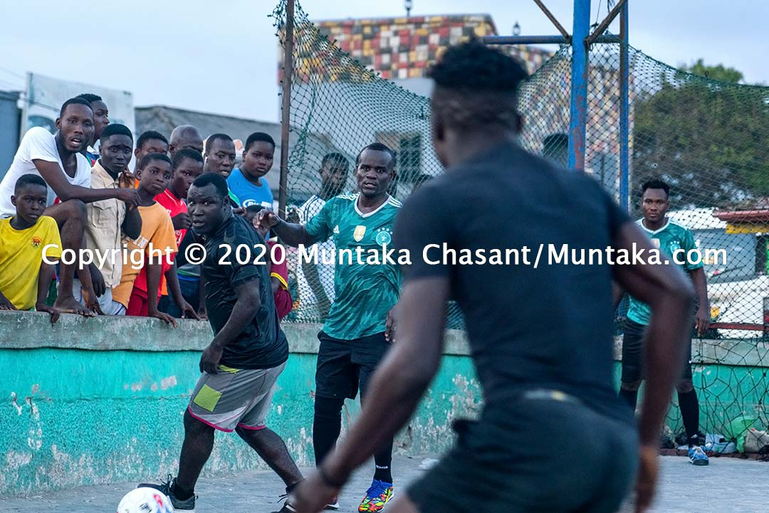 Street soccer image: Joshua Clottey and other Jamestown residents play soccer on the street at Jamestown in Accra, Ghana's capital city. Copyright © 2020 Muntaka Chasant