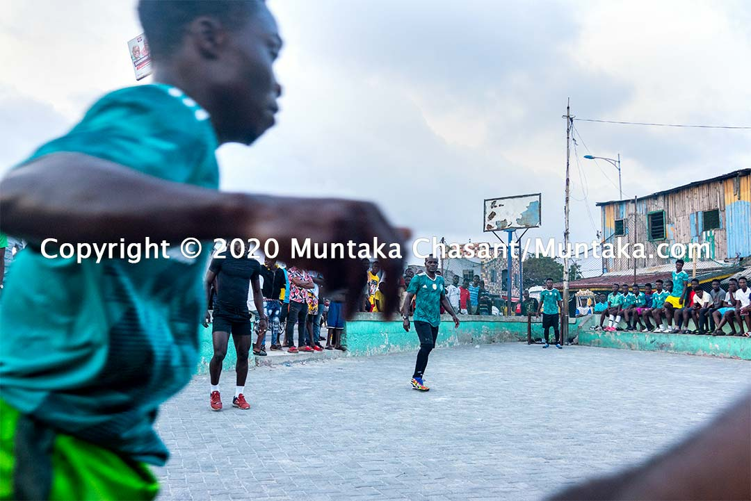 Street soccer in Ghana: Jamestown residents, including the Ghanaian former professional boxer Joshua Clottey, play soccer on concrete at Jamestown, a suburb in Accra, Ghana's capital city. Copyright © 2020 Muntaka Chasant