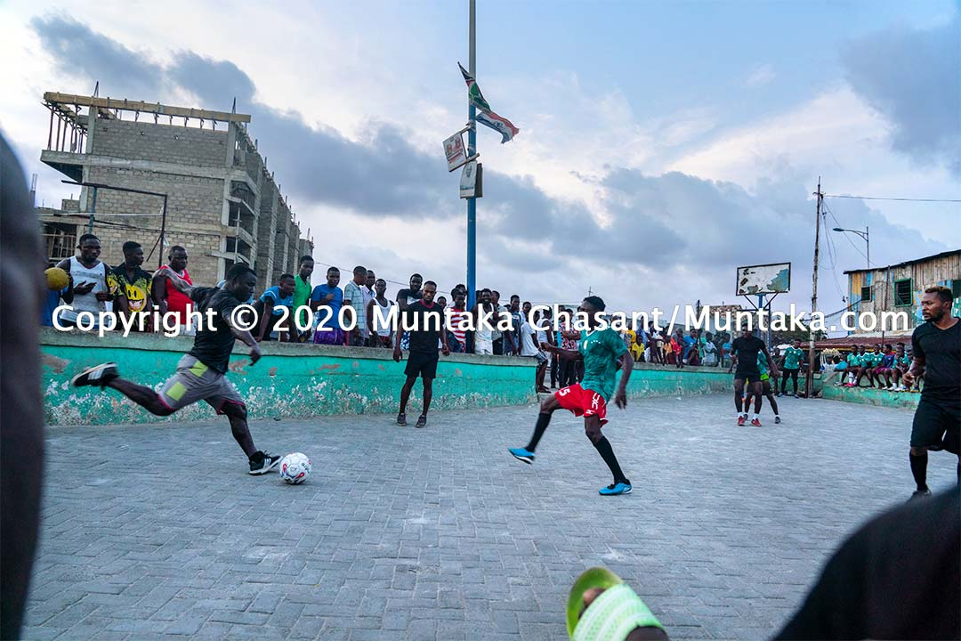 Street football in Ghana: Jamestown residents, including the boxer Joshua Clottey, play football on the street at Jamestown, Accra, Ghana. Copyright © 2020 Muntaka Chasant