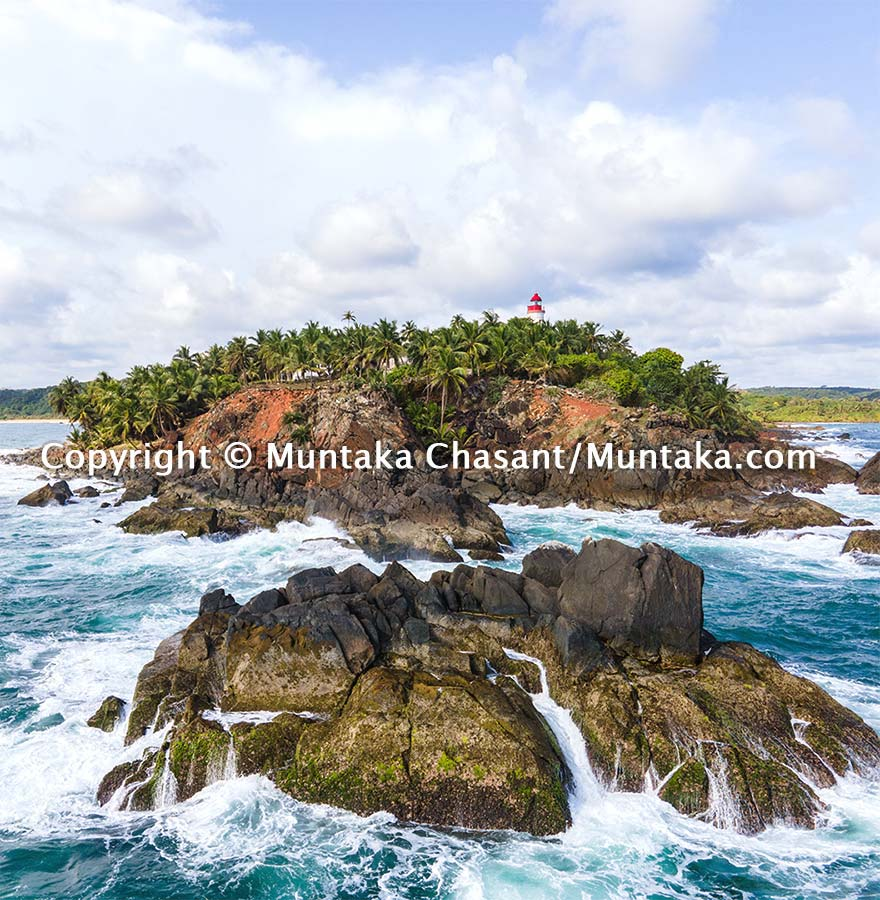 Aerial view of Cape Three Points, the southernmost tip of Ghana. This islet is also the nearest land to the Null Island — 570 km south — at zero degrees latitude and longitude (0°N 0°E) in the Atlantic Ocean. Copyright © Muntaka Chasant