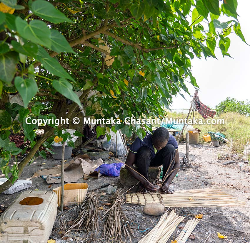 A fisherman in Ghana makes a blue crab trap. Copyright © Muntaka Chasant