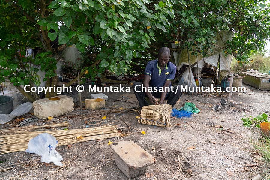 Handmade blue crab trap making. Copyright © Muntaka Chasant