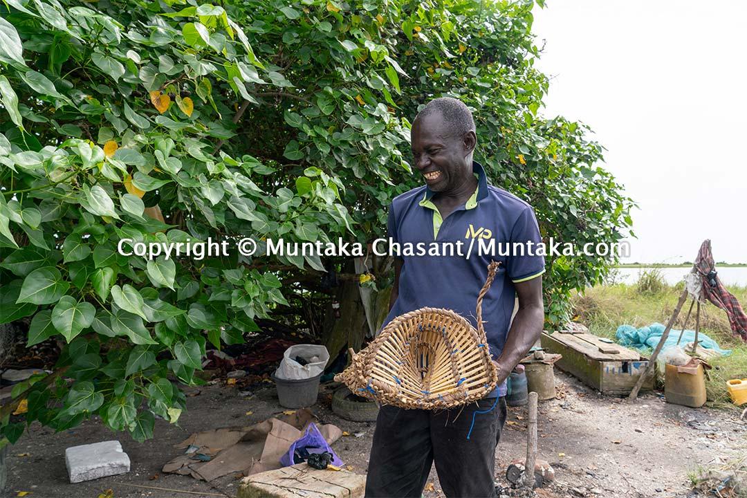 Fisherman smiles. Copyright