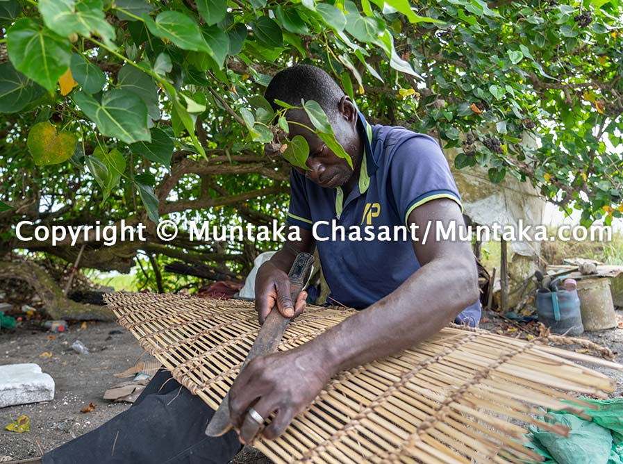 A fisherman handmakes a crab trap in Ghana. Copyright © Muntaka Chasant