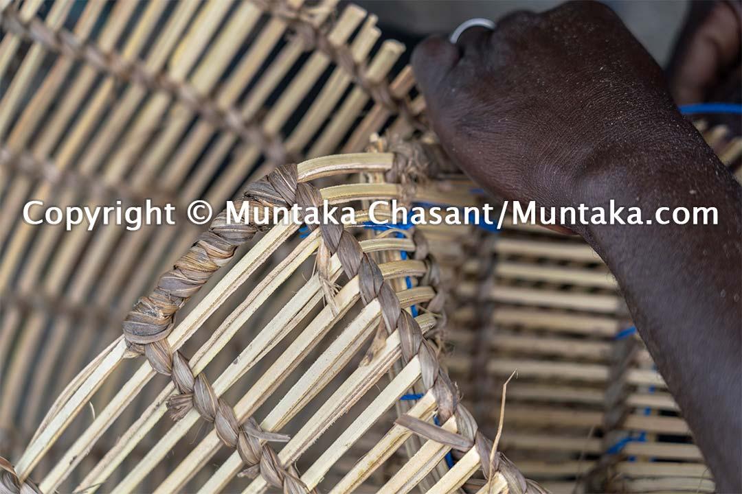 Blue crab trap making. Copyright © Muntaka Chasant