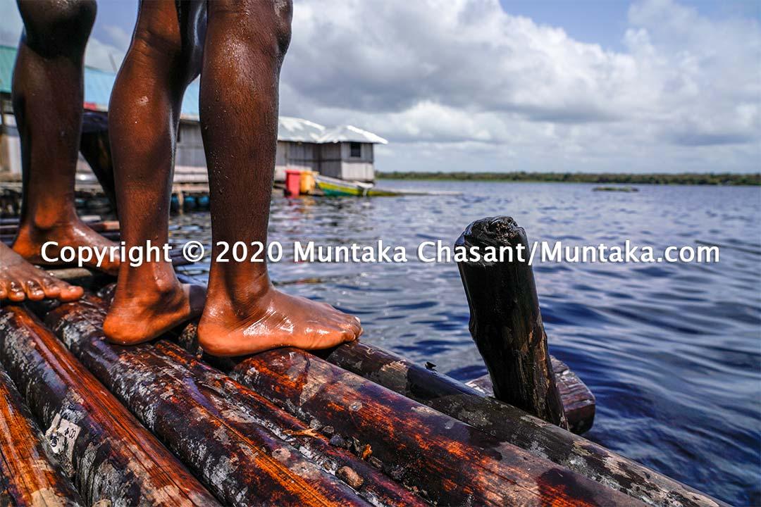 Nzulezo children about to jump into the Amanzuri lake. Copyright © 2020 Muntaka Chasant