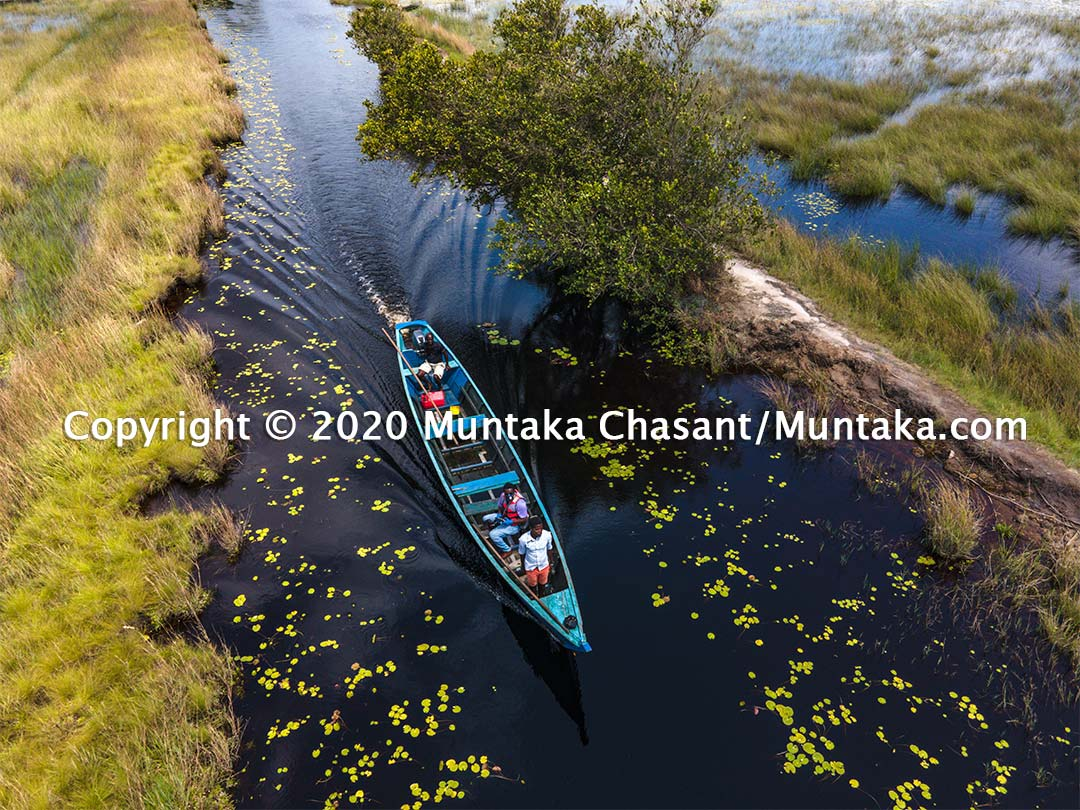 Tourism in Ghana: A motorboat ride on the artificial creek that links Beyin and the Amanzuri wetlands (to the Nzulezo stilt village). Copyright © 2020 Muntaka Chasant