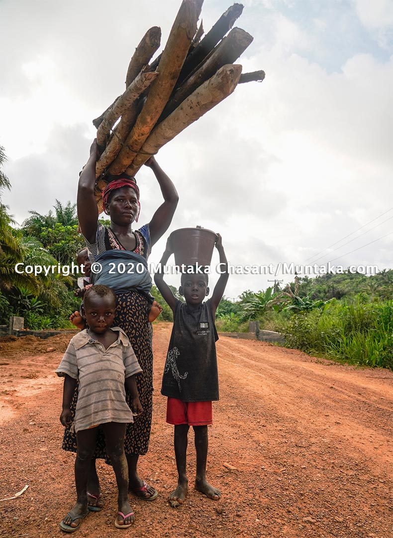 A poor woman with her three children in rural Ghana. Copyright © 2020 Muntaka Chasant