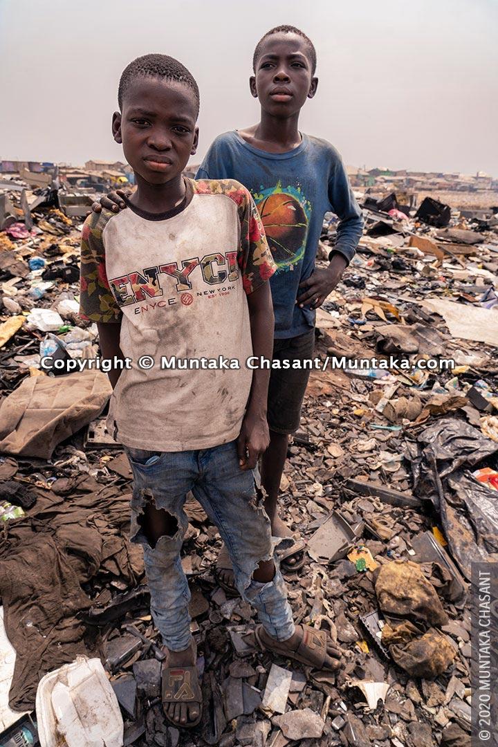 Adama, 13 years old, and Malik, 14, at Agbogbloshie, Ghana. © 2020 Muntaka Chasant