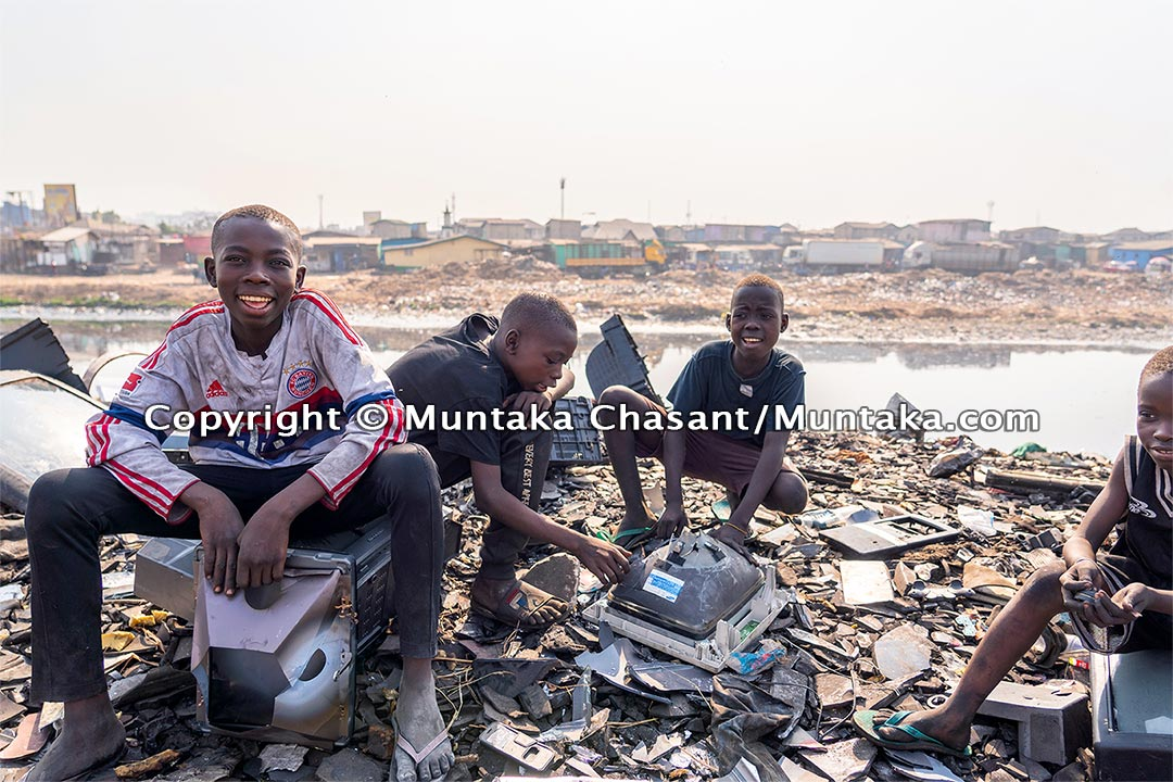 From left to right: Malik, Adama, and Twum. Agbogbloshie, Ghana. © 2020 Muntaka Chasant