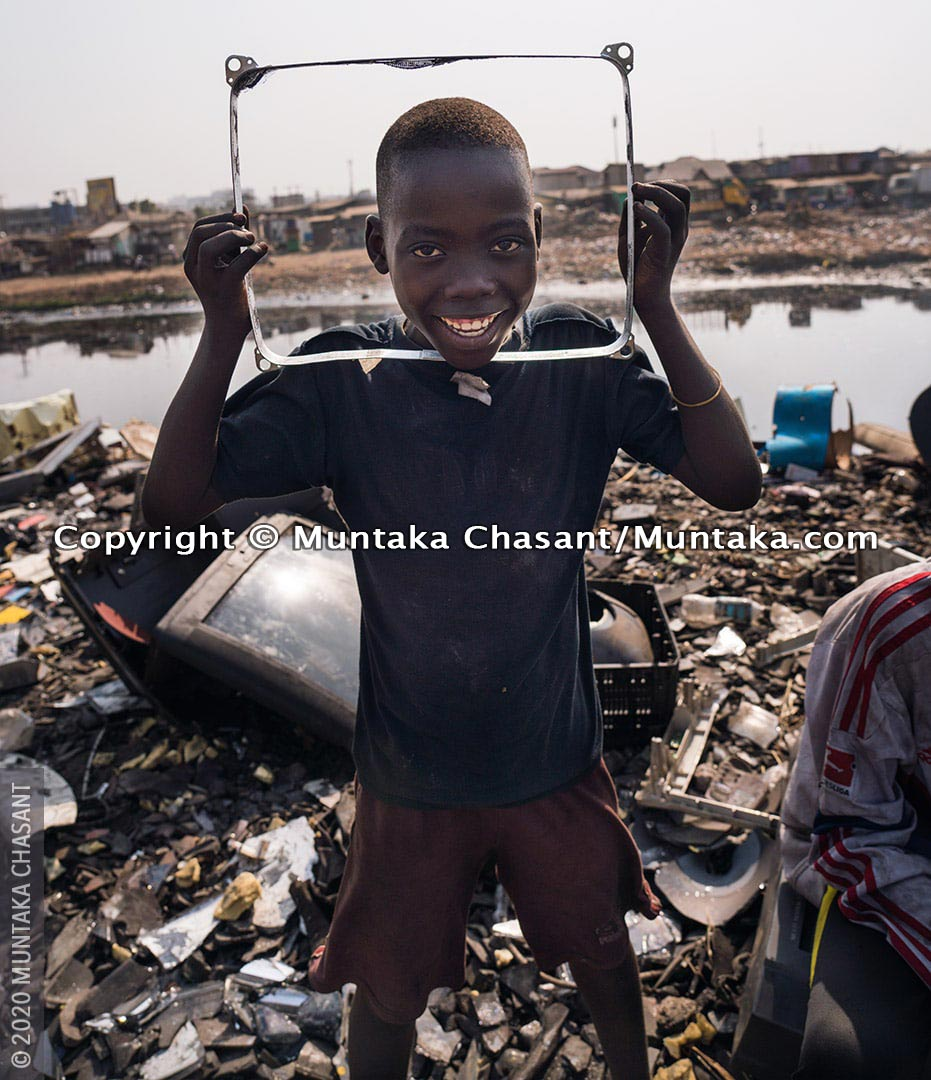 Child labour: 12-year-old Twum is engaged in hazardous child labour at Agbogbloshie, Ghana. He uses his bare hands, stones, and hammers to break apart e-waste for the precious metals inside. © 2020 Muntaka Chasant