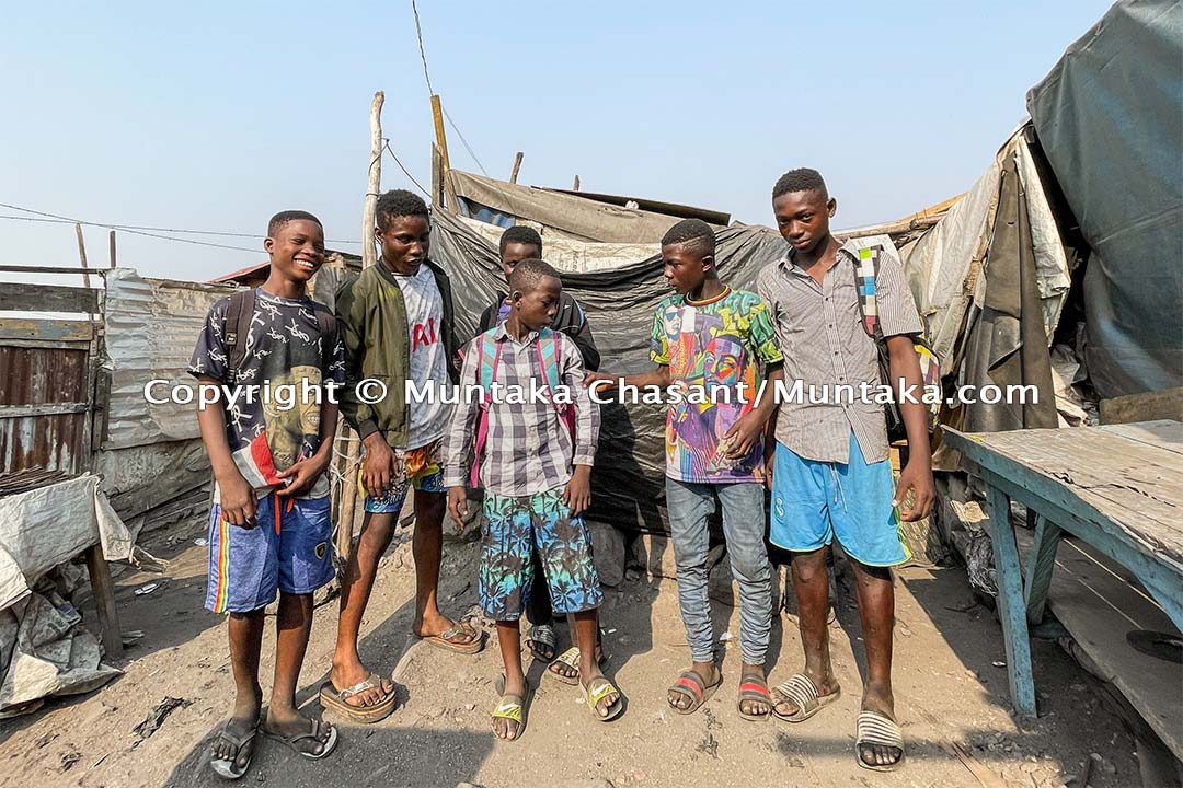 From left to right: Bright Ankrah, 14 years old, Gideon Asante, 17, Kingsford Sarfo, 14, Natus Frimpong, 13, Emmanuel Osei, 15, and Benjamin Baidoo, 15. Some of them sleep out the area. This was after picking up new school uniforms, books, and other materials for starting public school the following day. Copyright © 2021 Muntaka Chasant