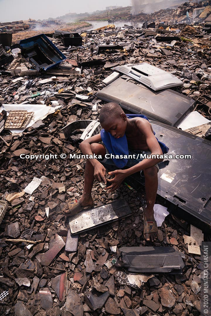 Hazardous child labour: 13-year-old Adama was engaged in hazardous child labour at Agbogbloshie, Ghana. He used his bare hands to pick scrap metals deposited in the soil in an area known for its heavy metals pollution. © 2020 Muntaka Chasant